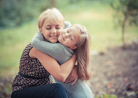 outsides: beautiful young mother and her daughter in the park