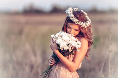 plait: beautiful girl in a camomile wreath