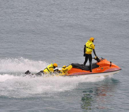 Volvo Ocean Race lifesaver man taking action in water, Volvo Village Area Alicante Bay, October 2.011 Editorial