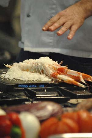 chef cookin a seafood in salt preservation, LMG Culinary Congress IFA Alicante, Spain. 2.011