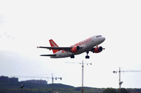 air bus easyjet airline flying over alicante terminal airport, Alicante 30 September, 2.012 Stock Photo - 15485236