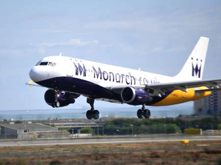 monarch air bus flying over in maniobre aproximation airport alicante, Spain 30th September 2.012 Stock Photo - 15485246
