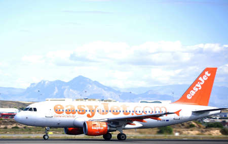 easy jet airbus airplane taking aproximation maniobre in airport Alicante, Spain. 30 September, 2.012 Stock Photo - 15485242