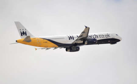 Airbus A-320 Monarch Air, flying in Alicante Airport, 29 September 2.012. Alicante, Spain. Stock Photo - 15485240