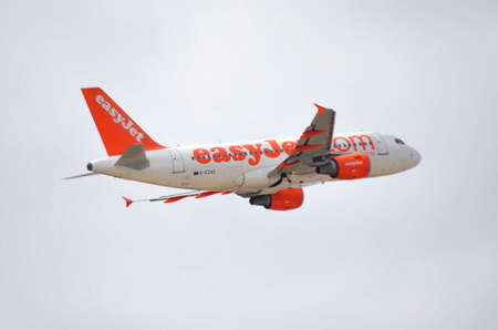 easy jet airbus airplane taking direction control in air leaving terminal airport of Alicante, 30th September 2.012