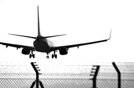 landing plane in airport of Alicante in black and white airplane silhouette Alicante 30 September 2.012