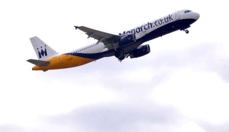 monarch air bus flying over in maniobre of department airport alicante, Spain 30th September 2.012 Editorial