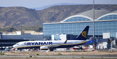 ryanair in flight terminal of passengers of alicante airport using fingers. 4th October 2.012. Editorial