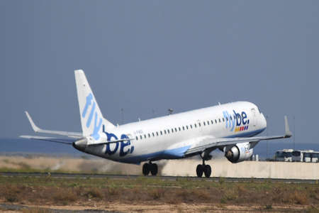 flybe airline aircraft plane take elevation in airport of alicante, 6th October 2.012