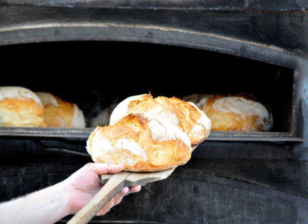 making bread in traditional oven preparation for cook Stock Photo