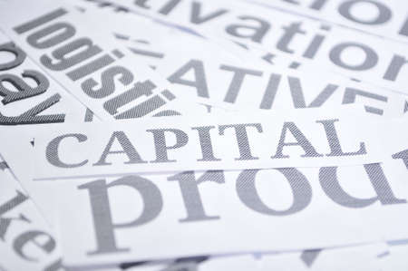 capital word isolated white background economy concept  photo