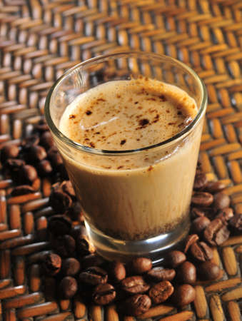 coffe with milk breakfast with grain coffee beans over wood texture photo