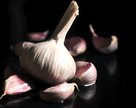 garlic in kitchen isolated black Stock Photo
