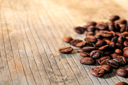coffee beans in a wood background