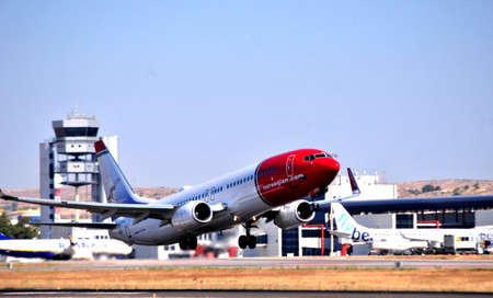 norwegian airline boeing 737 air takes elevation in alicante airport, spain Editorial