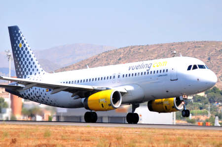 vueling air lines in airport of alicante, spain Editorial