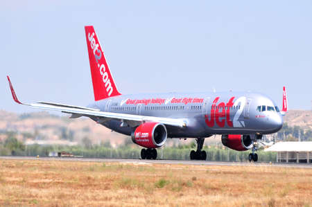 jet 2com airline boeing in runnig central zone of airport of alicante, spain