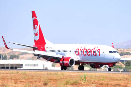 airberlin aircraft flying turbine power running at airport of alicante, spain