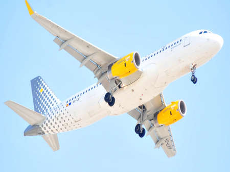 vueling air lines in area of flying sky near airport of alicante, spain