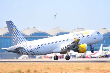 vueling air company takes elevation in alicante airport, spain