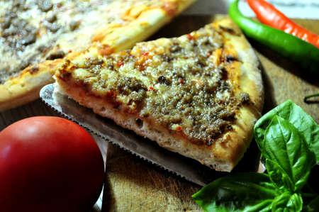 elaboration: clasical pizza and ingredients for italian elaboration cuisine