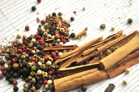 peppercorns and stick of cinammon  photo