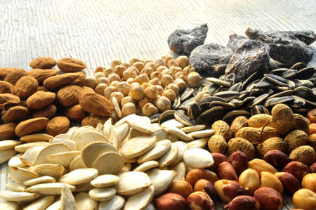 snack time: snack time background nuts and seed Stock Photo