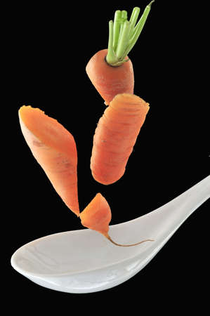 carrots sliced and flying in air  photo