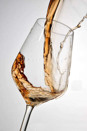 white wine splash in glass