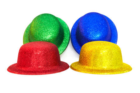 varicoloured hats on white background for holiday
