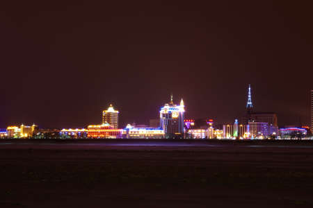 Panorama of the night city in neon lights  Stock Photo