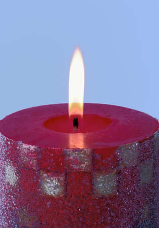 Beautiful red candle on blue background  Stock Photo