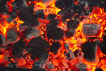 wood burning: Decaying coals for cooking and a background