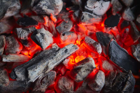 Decaying coals for cooking and a background photo
