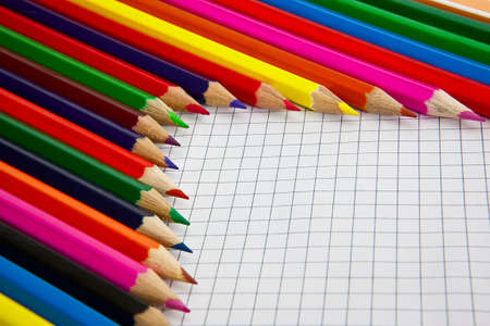 color pencils a writing-book leaf in a section Stock Photo