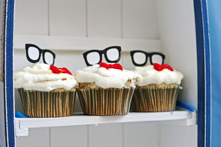 fancy sweet box: Birthday Cupcakes With Glasses And Red Bow Tie