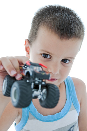 monster truck: Cute boy shows his monster truck, white background