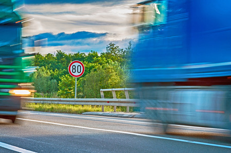Maximum speed limit and two trucks in motion