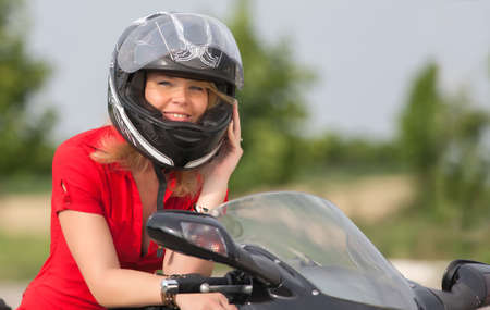 Girl in red and the motorcycle  photo