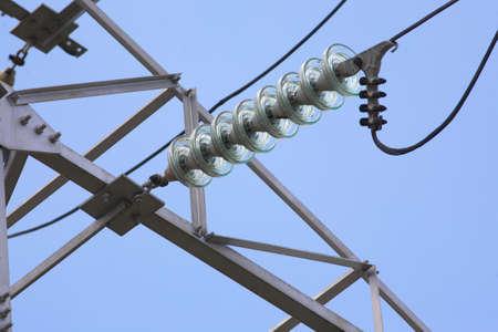 insulators: Insulators power lines close in the sky Stock Photo
