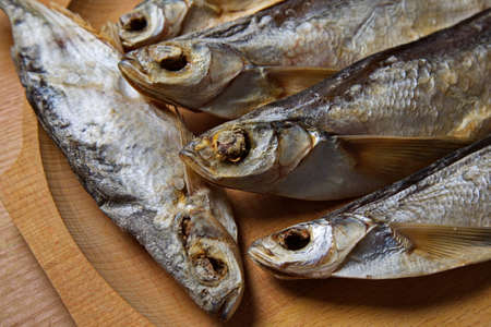 stockfish: Dried fish on a wooden tray. Stockfish.