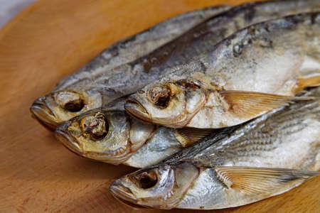 stockfish: Stockfish sabrefish on the table. Natural food.
