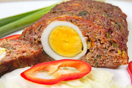 Meatloaf with egg. Stock Photo