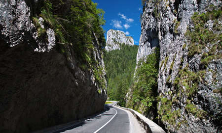 rockclimber: BICAZ GORGES, ROMANIA: Tourists visit the Bicaz Canyon. Canyon is one of the most spectacular roads in Romania. Spectacular mountain passage in Transylvania. Stock Photo