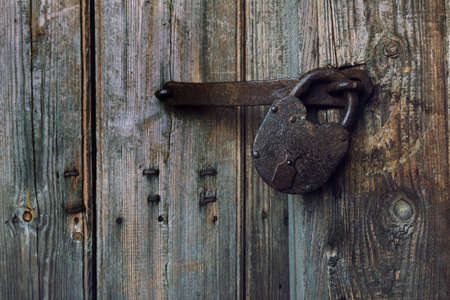 An old wooden door with an old lock.