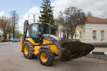 Kolomna, Russia - MAY 03, 2019: A excavator is working for renewal of city park in small Russian town