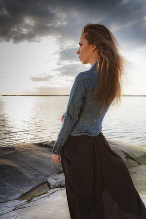 Beautiful young lady by the Baltic Sea