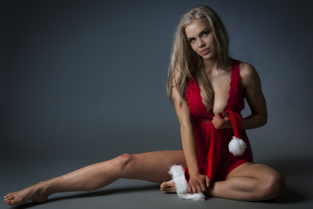 hat nude: Young pretty lady waiting for Christmas Stock Photo
