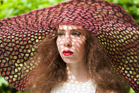 elegancy: Elegant young lady wearing a red hat Stock Photo
