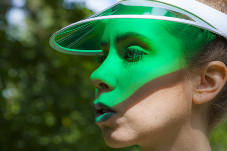 visor: Young attractive lady wearing a green visor